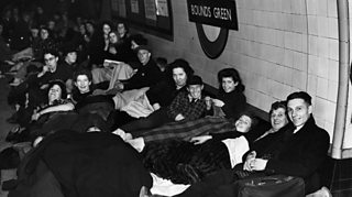 Londoners shelter in an underground station during the blitz in 1940