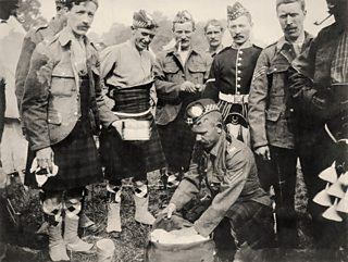 Highland troops in kilts pack their kits in World War One