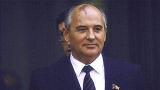 Balding man in pinstripe suit