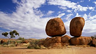 Boulders balanced on top of rocks.