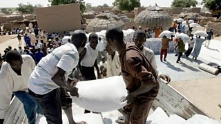 Men unloading food aid bags in Niger