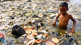 Child playing in polluted waterin Jakarta, Indonesia