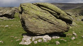 An erratic in the centre of a field