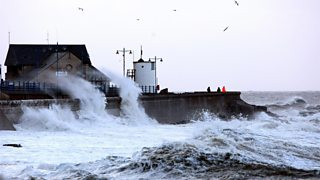 Massive waves crash into the seafront at PorthCawl in Wales