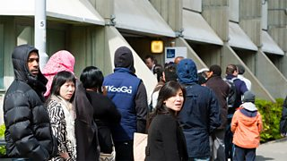 People queueing outside the UK Border Agency