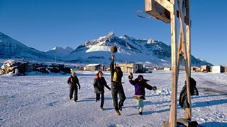 People playing basketball in the snow in Alaska