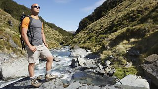 Man stood in a v-shaped valley