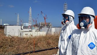 Scientists wearing safety clothing near the Fukishima nuclear plant