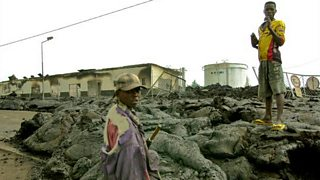 People inspect the damage after the Nyiragongo volcano hits Goma, DR Congo