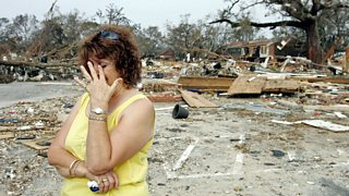 Woman in distress outside a home destroyed by Hurricane Katrina