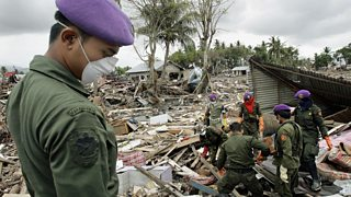 The army search the rubble for bodies after the tsunami in Banda Aceh, Indonesia