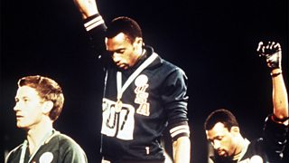 Tommie Smith, and John Carlos show raised fists on the podium in the 1968 Olympics