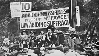 Millicent Fawcett surrounded by other suffragists