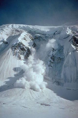 Avalanche tumbling down a snowy hillside