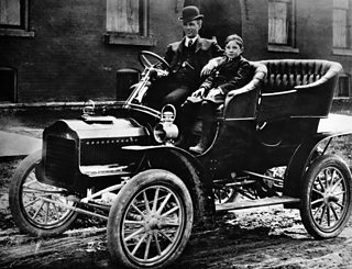 Henry Ford and his son posing in the model F Ford car in 1905.