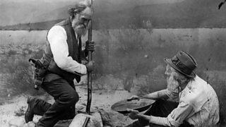 Two men prospecting for gold in California