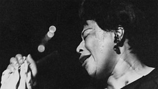 Ella Fitzgerald, a famous jazz singer, performing on stage