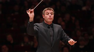 A conductor conducts his orchestra
