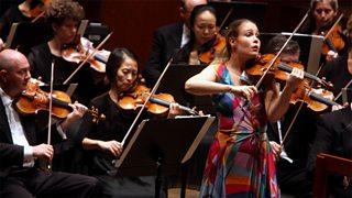 A violinist performing a violin concerto