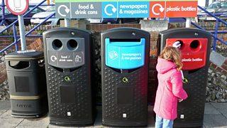 Girl recycling bottles