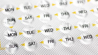 Birth control pills in pharmaceutical packaging.
