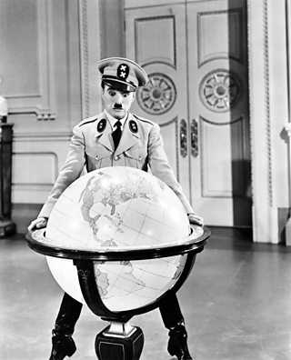 Charlie Chaplin performing in the film The Great Dictator