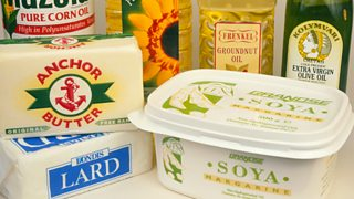 A selection of fat and oil-based products such as vegetable oil, lard, margarine and groundnut oil