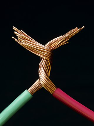 Two electrical cables with copper wires twisted together