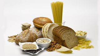 A range of starchy foods containing complex carbohydrates, including bread, pasta, rice and cereal