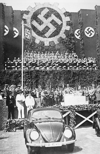 "Adolf Hitler launching the ""people's car"", the Volkswagen Beetle"
