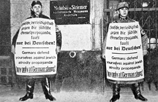 Nazi soldiers outside a Jewish shop during the 1933 April Boycott