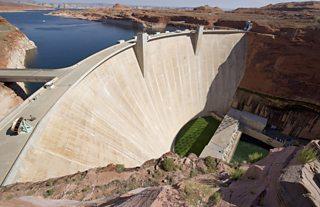 Large concrete dam in Arizona holding back reservoir