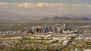 Cityscape of downtown Phoenix, Arizona with hills in the background