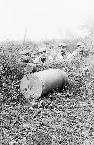 Soldiers beside a dud shell