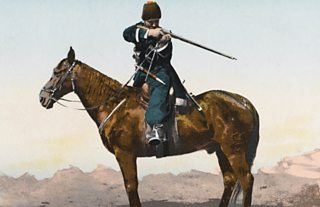 Cossack soldier on horseback aiming rifle