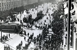 Cavalry police and large crowd of demonstators on a Russian street