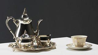 Silver tea set and China tea cup