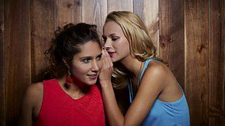 A women whispering a secret