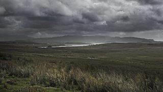 A bleak Scottish landscape with grey skies