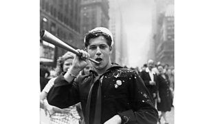 A sailor blows a horn during the VJ Day celebrations in Times Square, New York (1945)