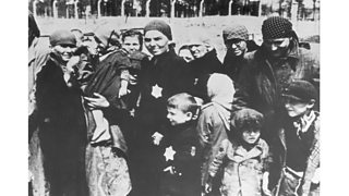 Jewish women and children, some wearing the yellow Star of David patch on their chests, at Auschwitz concentration camp, Poland, undergoing selections.