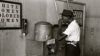 A water cooler marked 'colored' in streetcar terminal, Oklahoma.