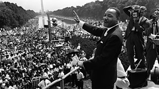 The civil rights leader Martin Luther King Jr waves to supporters 28 August 1963 during the 'March on Washington'.