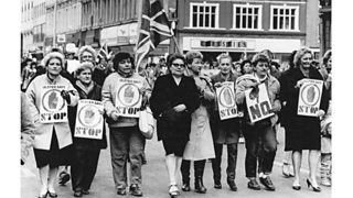 Women protesters with 'Ulster says No' posters marching to the rally outside City Hall Belfast (3rd March 1986)