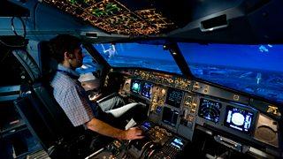 Man using a flight simulator