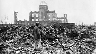 A man stood on the rumble after the atomic bomb attack in Hiroshima.