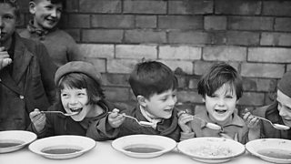 Children enjoying a free lunch at school.