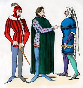 A medieval lord with his valets
