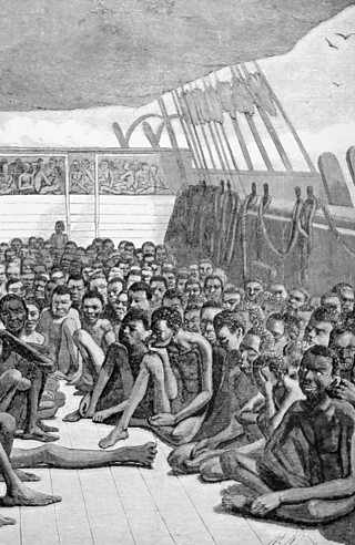 An engraving showing African slaves being taken by ship to America