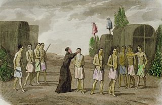 An engraving showing a row of slaves being baptised by a priest